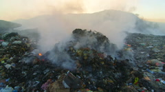 Toxic smoke from burning dump rises into the air - stock footage