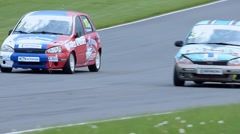 Race cars chase each other Stock Footage
