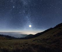 Moonrise in the mountains - stock photo