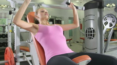 Young woman training in free weights area at health fitness club Stock Footage