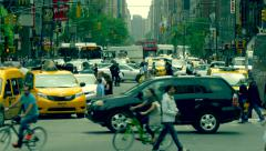 Heavy street traffic busy rush hour Manhattan commuting cars pedestrians NYC day Stock Footage