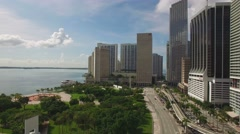 Aerial horizontal backward shot is along the busy road in Downtown of Miami. 4K. - stock footage
