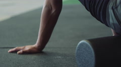Cinematic closeup of female on foam roller Stock Footage