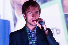 The oppositionist Mikhail Konev speaking at the opposition rally - stock photo