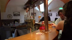 Visitors at the bar counter in the pub 'U Medvidku'. Prague Stock Footage