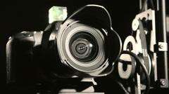 Remote hot head camera crane closeup in dark studio - stock footage