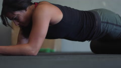 Low angle of female athlete on foam roller Stock Footage
