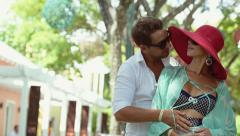 Young couple walking in the park Stock Footage