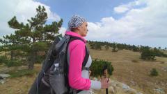 JIB CRANE: Woman day hiking walking off trail on majestic mountain plateau Stock Footage