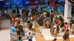 Passengers waiting in line at the Air Asia departure check-in counter Stock Footage