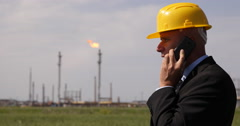 Business Man Wear Helmet Refinery Plant Cellphone Talking Free Market Fuel Price Stock Footage