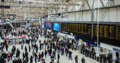 Time lapse of passengers passing through London Waterloo train station Stock Footage
