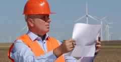 Environmental Protection Green Energy Engineer Checking Wind Turbine Project - stock footage