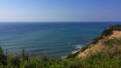 Steady Pan from Bluff Overlooking the Ocean Stock Footage