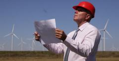 Businessman Wind Turbines Developer Examine Renewable Alternative Energy Sheets Stock Footage