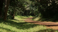 A Landrover drives down a rural road in Uganda, Africa Stock Footage
