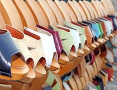 wooden clogs in the artisan market - stock photo