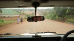 Interoior shot of an old Landrover defender focussed on the rear view mirror - stock footage