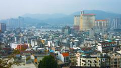 Macau's urban skyline in the hazy, afternoon light. Stock Footage