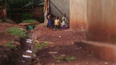 Young African children playing in an slum in Uganda Stock Footage