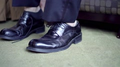 Putting shoes on Stock Footage