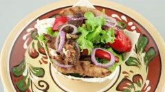 Fresh salad in the pita bread on the decorative plate Stock Footage