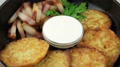 Potato pancakes with pork lard closeup Stock Footage