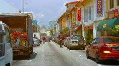 Pedestrians Walk past Various Businesses in the Indian Quarter of Singapore Stock Footage