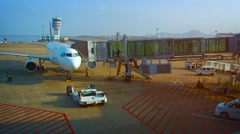 Passengers boarding their aircraft through a docking sleeve Stock Footage
