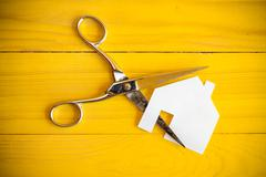 Stock Photo of Scissors and house cut out of pape