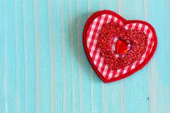Stock Photo of Heart on wooden background with copy-space