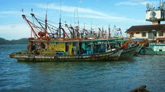 Traditional, wooden fishing boats tied together at a pier in Borneo, Malaysia Stock Footage