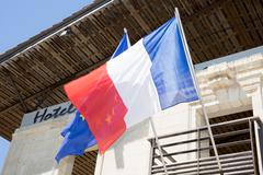 French flag under a blue sky - stock photo
