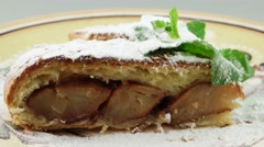 Apple strudel on the decorative plate Stock Footage