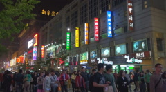 Crowded Wangfujing street shopping road night Beijing landmark commercial neon  Stock Footage