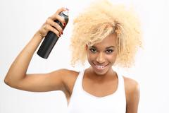 Female hair lacquer sprayed with a fixative hair Stock Photos