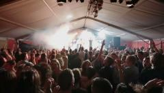 Audience jumping with strobe lights at a festival - stock footage