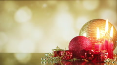 Christmas balls and candle on shiny background seamless loop Stock Footage