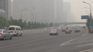 Stock Video Footage of Traffic car busy highway Beijing business center financial building smog foggy