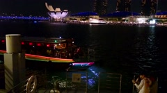 Boat River Cruise Reversing In Front Of Marina Bay Sands, Singapore Stock Footage