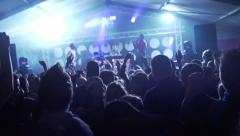 Audience jumping with the stage on the background Stock Footage