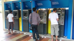 Stock Video Footage of Customer Withdrawing Money From ATM Machine
