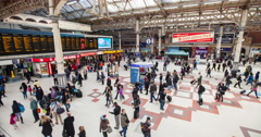 Time lapse of commuters passing through London Victoria train station Stock Footage