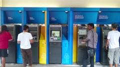 Customer Withdrawing Money From ATM Machine Arkistovideo