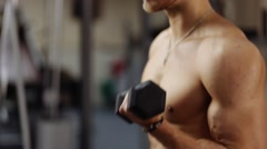 Stock Video Footage of One-at-a-Time Biceps Curl with Dumbbells