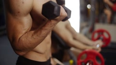 Biceps curls with barbells. Closeup - stock footage