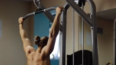 Wide-grip pull down in gym machine for back - stock footage