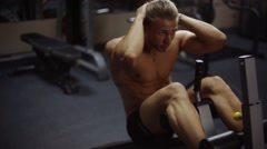 Stock Video Footage of Abs crunches on bench. Loop