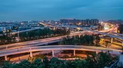 China, the city of chengdu night at intersection delay, day to night - stock footage