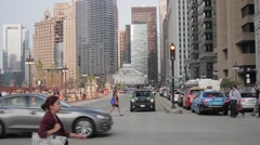 People crossing a city intersection Stock Footage